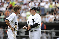 CHICAGO - JULY 27:  Gordon Beckham #15 talks to third base coach Jeff Cox #8 of the Chicago White Sox during the game against the Detroit Tigers on July 27, 2011 at U.S. Cellular Field in Chicago, Illinois.  The White Sox defeated the Tigers 2-1.  (Photo by Ron Vesely)  Subject: Gordon Beckham;Jeff Cox