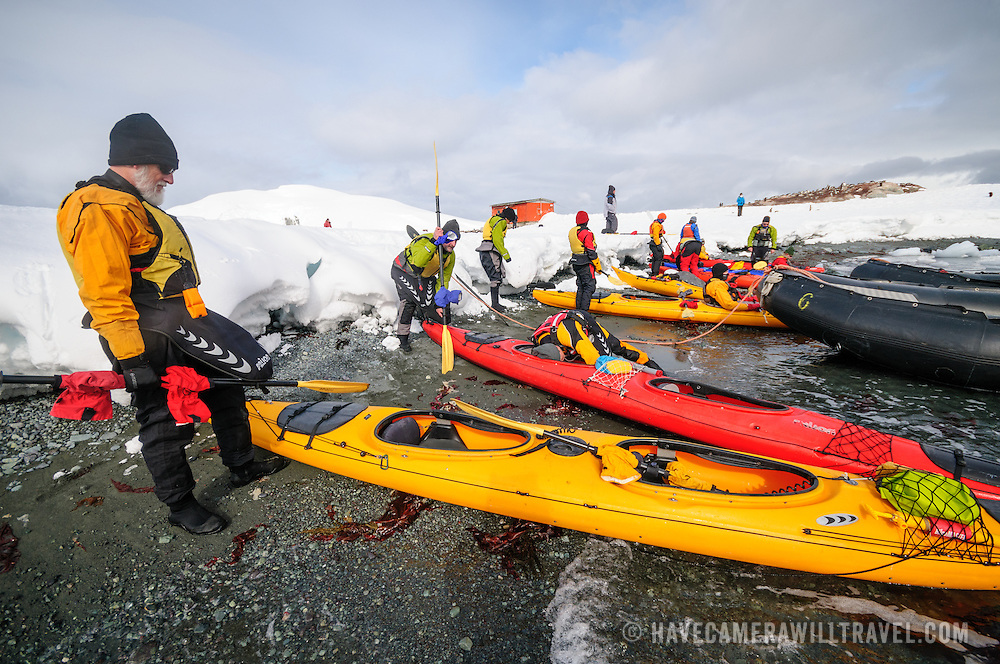 Kayakers ready their kayaks for a shore launch in Mikkelsen Harbour on Trinity Island in Antarctica.