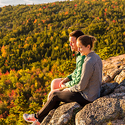 """Emily Peterson and Connor Huggins on """"The Beehive"""" in fall in Maine's Acadia National Park."""