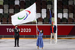TOKYO, JAPAN - SEPTEMBER 05: Paris Mayor Anne Hidalgo (C) waves the Paralympic flag after receiving it from International Paralympic Committee President Andrew Parsons during the Closing Ceremony of the Tokyo 2020 Paralympic Games at Olympic Stadium on September 5, 2021 in Tokyo, Japan. Photo by Vid Ponikvar / Sportida