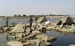 April 29, 2017 - Allahabad, Uttar Pradesh, India - Policeman raids at the illegal liquor factory and destroys the raw materials used to make liquor at Ghurpur area in Allahabad. (Credit Image: © Prabhat Kumar Verma/Pacific Press via ZUMA Wire)