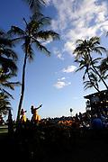 Female Hawaiian Hula dancers on stage, in front of audience. Oahu, Hawaii