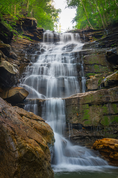 The falls on lower Butcher Branch cascade off the vertical rock wall within the vibrant greenery of the New River Gorge in West Virginia.