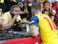 Arsenal's Jack Wilshere collects a scarf from a fan at full time <br /> <br /> Photographer Ashley Crowden/CameraSport<br /> <br /> Football - The FA Cup Final - Aston Villa v Arsenal - Saturday 30th May 2015 - Wembley - London<br /> <br /> © CameraSport - 43 Linden Ave. Countesthorpe. Leicester. England. LE8 5PG - Tel: +44 (0) 116 277 4147 - admin@camerasport.com - www.camerasport.com