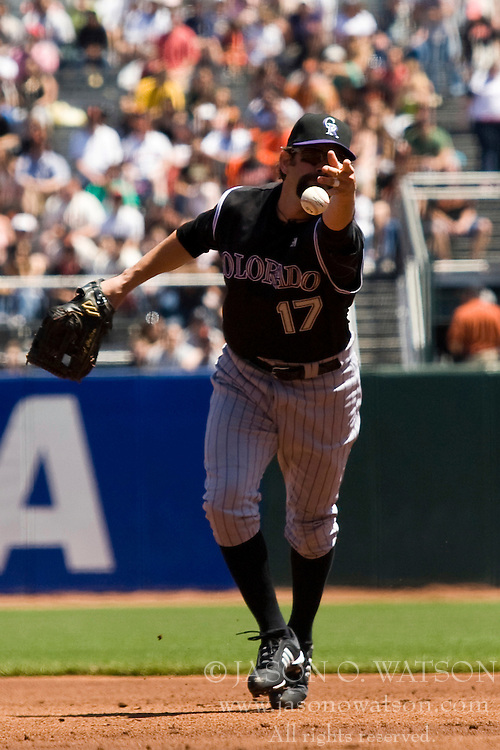 May 1, 2010; San Francisco, CA, USA;  Colorado Rockies first baseman Todd Helton (17) throws the ball to starting pitcher Esmil Rogers (not pictured) at first base against the San Francisco Giants during the first inning at AT&T Park.  San Francisco defeated Colorado 6-1.