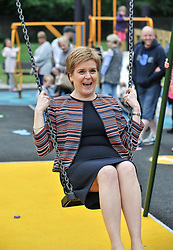 Pictured: Nicola Sturgeon tries out one of the swings for size.<br /> <br /> First Minister Nicola Sturgeon opened Scotland's largest 'inclusive' play park at Pittencrief Park in Dunfermline.<br /> <br /> © Dave Johnston/ EEm