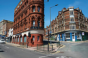 Old corner buiildings, now restaurants and takeaways, at Old Snow Hill in the Jewellery Quarter as the Coronavirus lockdown continues, the city centre is still very quiet while more traffic and people are returning, and with restrictions due to be relaxed further in the coming days, the quiet city may be coming to an end as businesses are set to start to reopen soon on 27th May 2020 in Birmingham, England, United Kingdom. Coronavirus or Covid-19 is a respiratory illness that has not previously been seen in humans. While much or Europe has been placed into lockdown, the UK government has put in place more stringent rules as part of their long term strategy, and in particular social distancing.