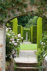 View through arch toward statue at Sissinghurst Castle Garden
