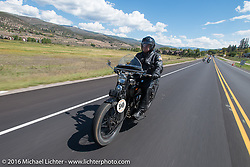 Mike Carson riding his 1924 Harley-Davidson JE during Stage 10 (278 miles) of the Motorcycle Cannonball Cross-Country Endurance Run, which on this day ran from Golden to Grand Junction, CO., USA. Monday, September 15, 2014.  Photography ©2014 Michael Lichter.