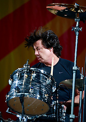 03 May 2013. New Orleans, Louisiana,  USA. .New Orleans Jazz and Heritage Festival. Maroon 5..Matt Flynn rocks JazzFest to the delight of a mud spattered crowd. .Photo; Charlie Varley.