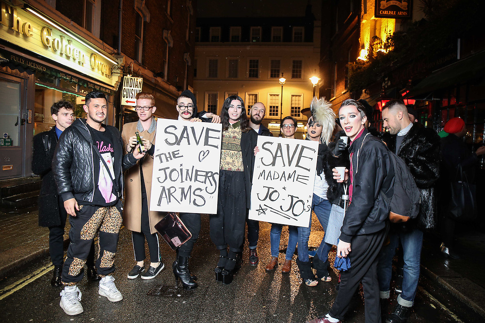 """Trannies protest in Soho against the closure of the Joiners Arms & Madame Jojos in Soho at the exhibition by celebrity portrait photographer Ki Price & Ted Rogers who art directed the collaboration called """"The House of Trannies"""" at the Milk Bar, 3 Bateman st, Soho December 4th 20142014.<br /> Photos by Ki Price"""