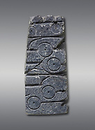 Fragment of a hittite mould from the Hittite capital Hattusa, Hittite New Kingdom 1650-1200 BC, Bogazkale archaeological Museum, Turkey. Grey  background