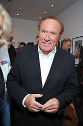 ANDREW NEIL at a private view of photographs by Marina Cicogna from her book Scritti e Scatti held at the Little Black Gallery, 3A Park Walk London SW10 on 16th October 2009.