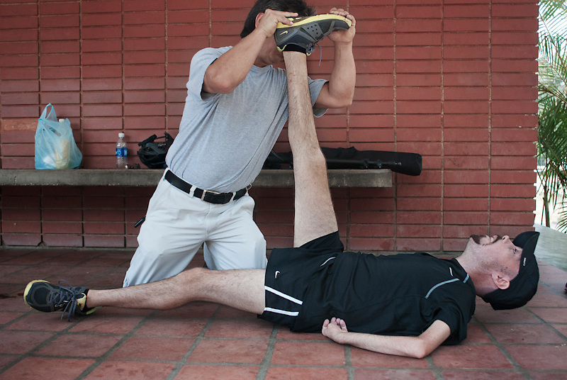 Galo Bermeo, Maickel's assistant for the past 15 years helps him stretch after 2 hours of training. March 18th, 2010.