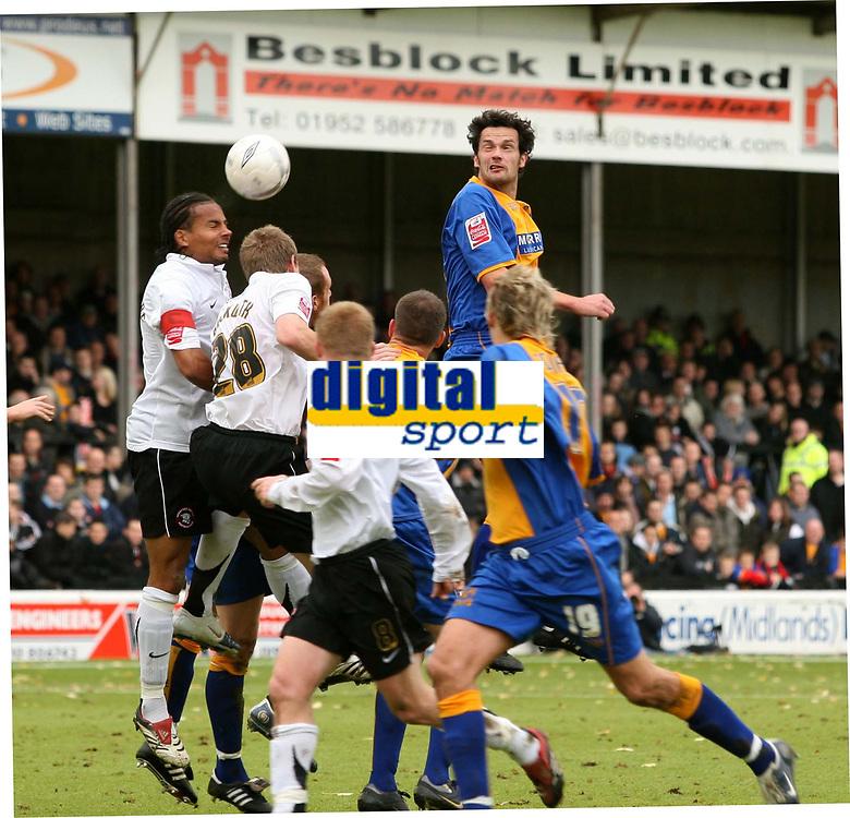 Shrewsbury town v Hereford,Fa cup first round.<br />11-11-2006.<br />Shrewsburys Stewart Drummond,top (R) heads a shot wide.