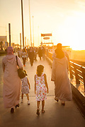 Family walking on corniche at sunset in Casablanca, Morocco