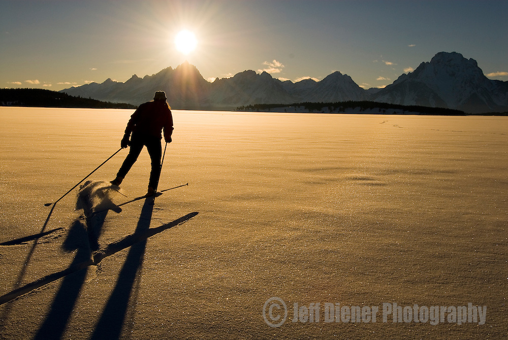 A young woman skate skis on Jackson Lake in Grand Teton National Park, Jackson Hole, Wyoming.