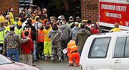 Rescue workers gather at the Oso fire station for a moment of silence for those lost in the mudsilde exactly one week ago in Oso, Washington March 29, 2014.  Family and friends of 90 people still missing after a wall of mud flattened the outskirts of a rural Washington state town increasingly feared for the worst on Saturday as the governor called for a statewide moment of silence a week after the disaster. REUTERS/Rick Wilking(UNITED STATES)