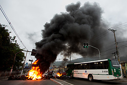 April 28, 2017 - Sao Paulo, Sao Paulo, Brazil - Protesters block an avenue with burning tires in Sao Paulo, during the general strike in Brazil, this Friday. The strike is against the proposed labor and pension changes. (Credit Image: © Paulo Lopes via ZUMA Wire)