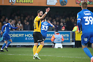 Southend United midfielder Stephen McLaughlin (11) not happy after AFC Wimbledon midfielder Callum Reilly (33) celebrates scoring goal during the EFL Sky Bet League 1 match between AFC Wimbledon and Southend United at the Cherry Red Records Stadium, Kingston, England on 1 January 2020.