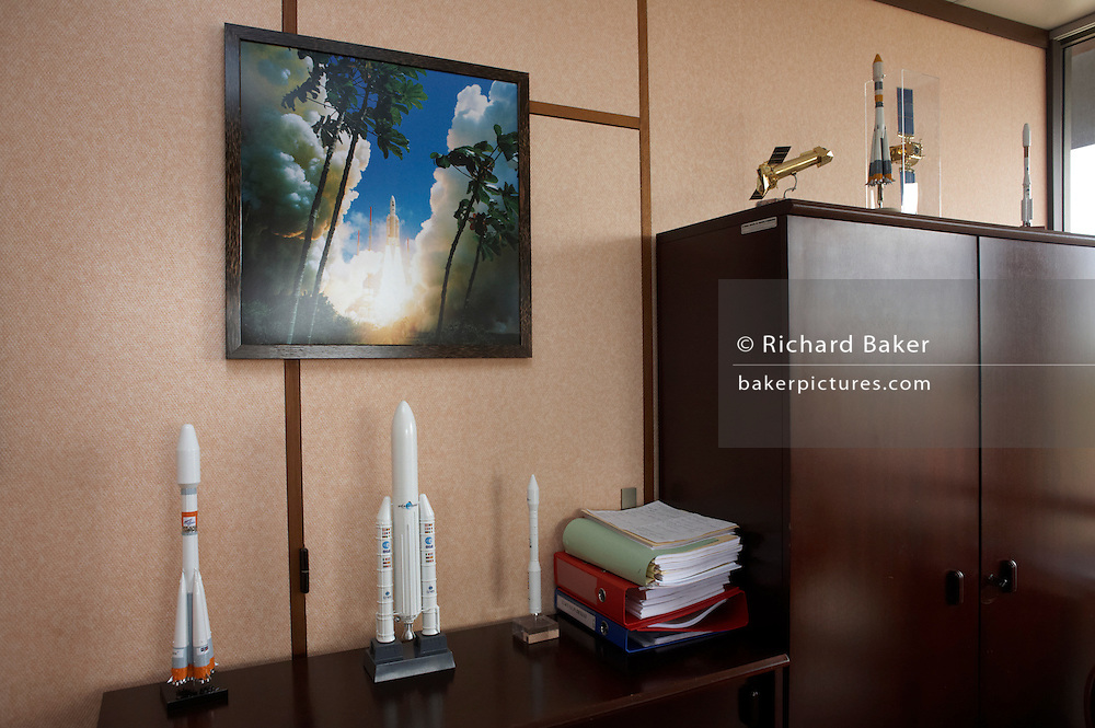 Ariane rocket launch and satellite models standing in the office of Michel Bartolomey, Head of Arianespace, French Guiana