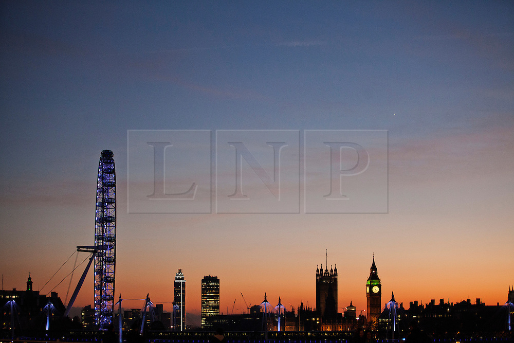 © Licensed to London News Pictures. 09/12/2013. London, United Kingdom. Westminster seen from Waterloo Bridge during the sunset. Photo credit : Andrea Baldo/LNP