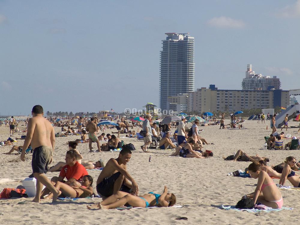 overview of sunbathers lying on beach Miami USA