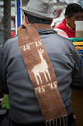 Detail of a man wearing scarf made from llama wool, Lima, Peru, South America