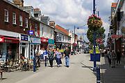 Shops and shoppers pedestrianised Hamilton Road, Felixstowe, Suffolk, England, UK