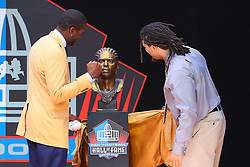 August 4, 2018 - Canton, OH, U.S. - CANTON, OH - AUGUST 04:  Randy Moss and his son Thaddeus unveil his Bust during the 2018 Hall of Fame Enshrinement Ceremony on August 4, 2018 at the Tom Benson Hall of Fame Stadium in Canton, Ohio  (Photo by Rich Graessle/Icon Sportswire) (Credit Image: © Rich Graessle/Icon SMI via ZUMA Press)