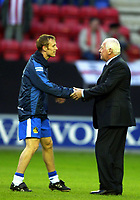 Photo: Chris Brunskill. Wigan Athletic v Sunderland Coca-Cola Championship. 05/04/2005. Wigan's multi-millionaire chairman Dave Whelan wishes new signing Brett Omerod good luck before the game
