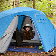 8 year old girl in a tent at Tulley Lake Campground, Royalston, MA, managed by The Trustees of Reservations.