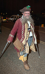 © Licensed to London News Pictures. 21/08/2015. Weston-super-Mare, North Somerset, UK.  DJ Dapper Dan (Christopher Brown) and the town crier for Wimborne, arrives for an evening party at Banksy's Dismaland. Guests arrive for an evening party at BANKSY's Dismaland show at the old Tropicana on Weston seafront. Photo credit : Simon Chapman/LNP