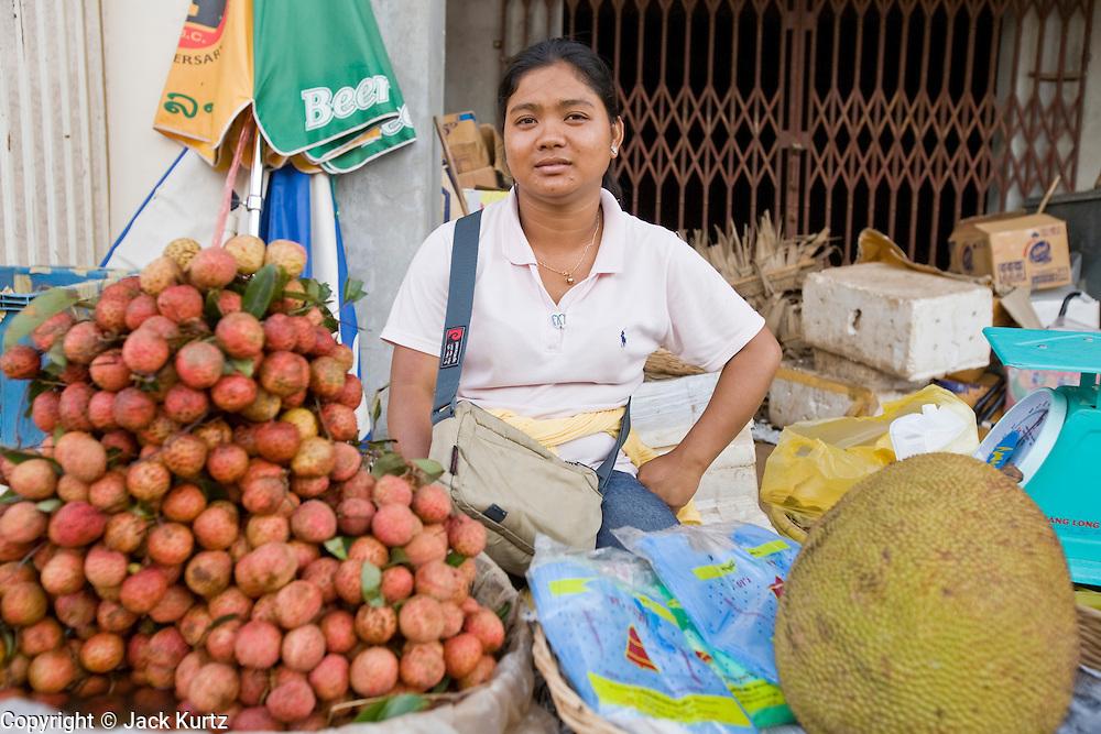 26 JUNE 2006 - SIEM REAP, CAMBODIA: A fruit vendor in the main market in Siem Reap, Cambodia, site of the world famous Angkor Wat. Photo by Jack Kurtz / ZUMA Press