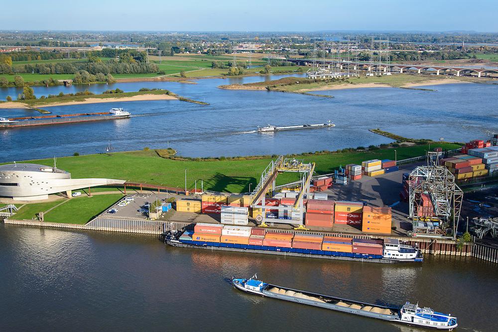 Nederland, Gelderland, Nijmegen, 24-10-2013. Noordkanaalhaven, gelegen aan de kruising van de Waal en het Maas-Waalkanaal. Containerterminal en overslag van kolen.<br /> Bruggen De Snelbinder en De Oversteek.<br /> Nederland, Gelderland, Nijmegen, 24-10-2013. Noordkanaalhaven, gelegen aan de kruising van de Waal en het Maas-Waalkanaal. Containerterminal en overslag van kolen.<br /> <br /> Port in Nijmegen (central Netherlands), container terminal and transshipment of coal . The river Waal and its bridge.<br /> <br /> luchtfoto (toeslag op standaard tarieven);<br /> aerial photo (additional fee required);<br /> copyright foto/photo Siebe Swart.