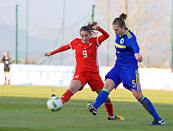 ZENICA, BOSNIA AND HERZEGOVINA - Tuesday, November 28, 2017: Wales' Kayleigh Green and Bosnia and Herzegovina's Melisa Hasanbegović during the FIFA Women's World Cup 2019 Qualifying Round Group 1 match between Bosnia and Herzegovina and Wales at the FF BH Football Training Centre. (Pic by David Rawcliffe/Propaganda)
