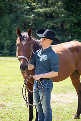 handsome cowboy with his horse outdoors
