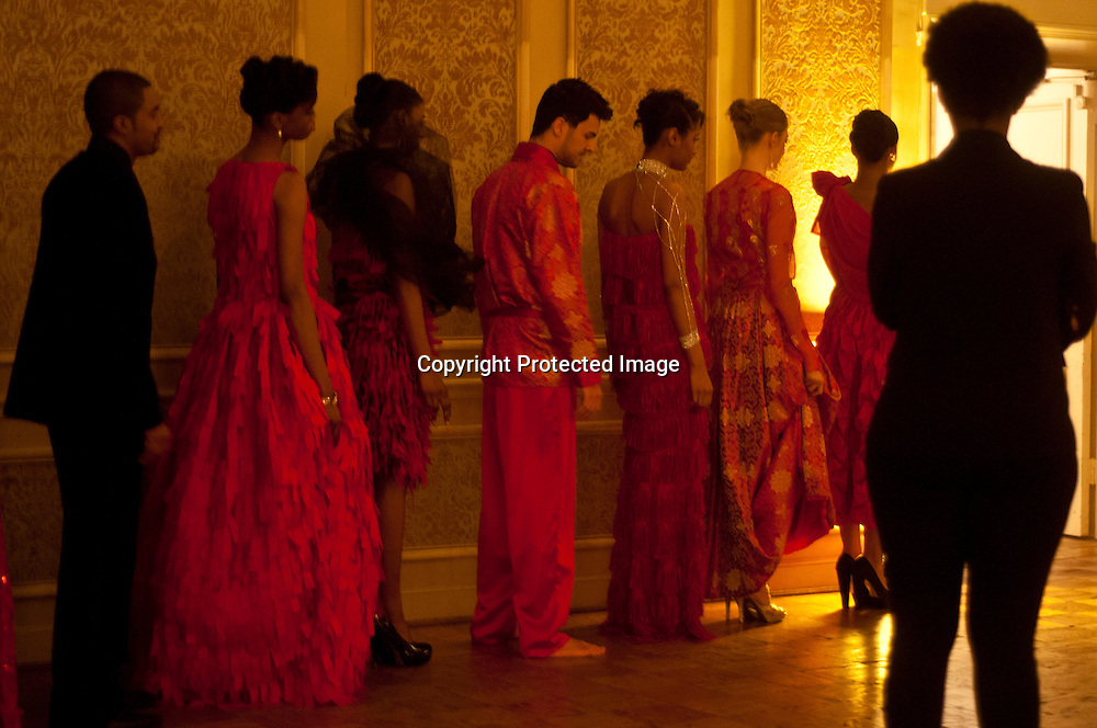 Models wait backstage during the Corjor International Fashion show at The Washington Club.