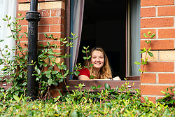 Glasgow, Scotland, UK. 24 September, 2020. Glasgow University students self isolating at home in Cairncross House a University of Glasgow hall of residence in the city.  This follows over 100 positive tests for Covid-19 at the university. Therefore, more than 600 students are now self-isolating inside their accommodation. Pictured;  Maths student Beth Haley has tested positive for Covd-19 and is self isolating in her flat. Iain Masterton/Alamy Live News