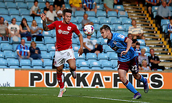 Conor Townsend of Scunthorpe United heads the ball away from Josh Brownhill of Bristol City - Mandatory by-line: Robbie Stephenson/JMP - 23/08/2016 - FOOTBALL - Glanford Park - Scunthorpe, England - Scunthorpe United v Bristol City - EFL Cup second round