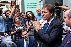 **2018 Pictures of the year by London News Pictures**<br /> © Licensed to London News Pictures. 18/07/2018. London, UK. SIR CLIFF RICHARD (2-R) as he leaves the Rolls Building of the High Court in London after winning his claim for damages against the BBC for loss of earnings. The 77-year-old singer sued the corporation after his home in Sunningdale, Berkshire was raided following allegations of sexual assault made to Metropolitan Police. Photo credit: Rob Pinney/LNP