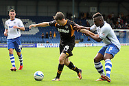 Newport County's Conor Washington holds off the challenge of Bury's Nathan Cameron (r) . Skybet Football League two match, Bury v Newport county at Gigg Lane in Bury on Saturday 5th Oct 2013. pic by David Richards, Andrew Orchard sports photography,