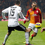 Galatasaray's Wesley Sneijder (R) during their Turkish superleague soccer derby match Galatasaray between Besiktas at the TT Arena at Seyrantepe in Istanbul Turkey on Sunday, 27 January 2013. Photo by Aykut AKICI/TURKPIX