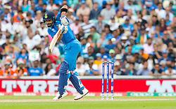Virat Kohli (capt.) of India flicks the ball off his hip