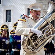 Kremlin brass band musician in white uniform with shiny tuba (Moskva (Moscow), Russian Federation - Aug. 2008) (Image ID: 080816-0922311a)