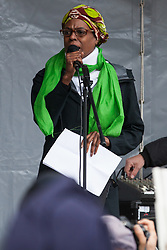 Southall, UK. 27th April 2019. Yvette Williams of Justice for Grenfell addresses members of the local community and supporters at a rally outside Southall Town Hall to honour the memories of Gurdip Singh Chaggar and Blair Peach on the 40th anniversary of their deaths. Gurdip Singh Chaggar, a young Asian boy, was the victim of a racially motivated attack whilst Blair Peach, a teacher, was killed by the Metropolitan Police's Special Patrol Group during a peaceful march against a National Front demonstration.