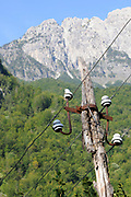 A dilapidated electricity pole and wires below the  Valbone Pass. Teth, Albania. 04Sep15