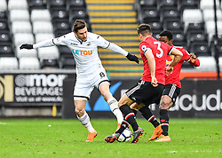 Adnan Maric of Swansea City is tackled by Joe Riley of Manchester United - Mandatory by-line: Craig Thomas/Replay images - 18/03/2018 - FOOTBALL - Liberty Stadium - Swansea, England - Swansea City U23 v Manchester United U23 - Premier League 2 - Divison 1