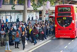 © Licensed to London News Pictures. 09/07/2015. London, UK. Commuters queuing for buses on Aldwych as tube strike shuts down the entire London Underground network on Thursday, July 9, 2015. The strike called by RMT, TSSA and Unite unions is a 27-hour stoppage by about 20,000 Tube staff and shuts down the entire London Underground network. Photo credit: Tolga Akmen/LNP