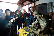 QUANZHOU, CHINA - JANUARY 10: (CHINA OUT) <br /> <br /> Workers clear the dust on monk Fuhou\'s body which was found not rotted after putting in a vat for three and a half years at Puzhao temple on Zimao Mountain on January 10, 2016 in Quanzhou, Fujian Province of China. 94-year-old monk Fuhou died in 2012 and his body was put by the sitting position into a vat with a cover for three and a half years. Monks found that Fuhou\'s body wasn\'t rotted on an opening vat rite on January 10 at Puzhao temple on Zimao Mountain in Quanzhou. The body would be cleaned and stuck with gold to be made into a golden Buddha.<br /> ©Exclusivepix Media